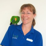 Sandy & one of her rescued Eclectus parrots