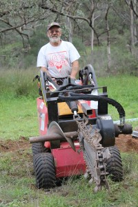 Larry with the trench digger. Trenches 92cms deep.Thank goodness for the trench digger!!